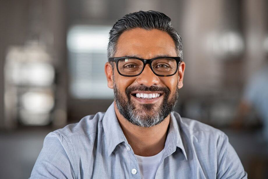smiling man with greying beard and glasses