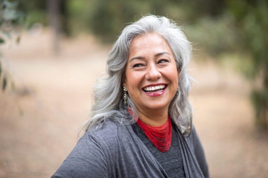 older woman outside, smiling