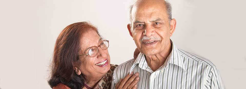 older man and woman, smiling