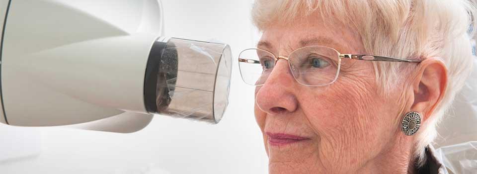 older woman receiving a dental x-ray
