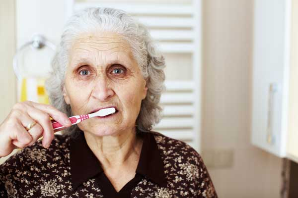Older Woman Brushing Teeth