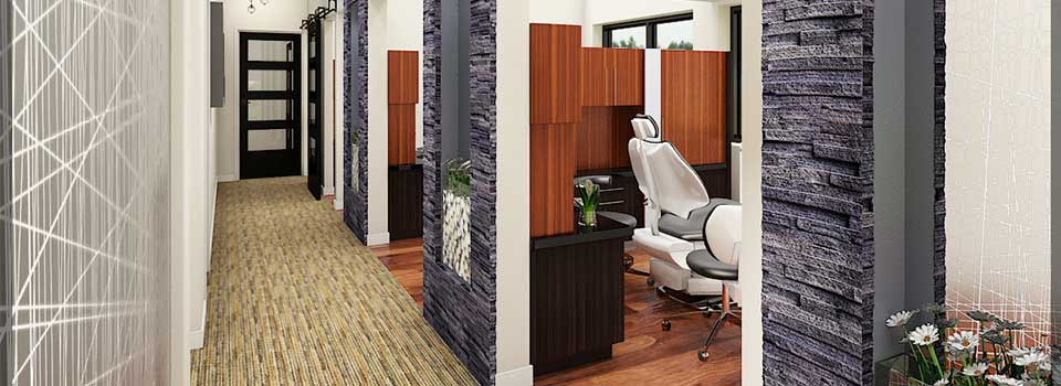 dental exam room with brown floors and cabinets